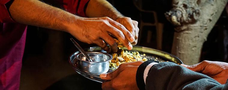 Crumbling the baati for dal baati churma in Gujarat